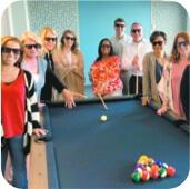 people around pool table